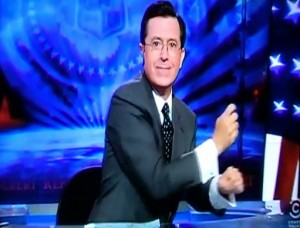 "Stephen Colbert does a horse ridding motion as he gives a shout out to ""Bronies"", My Little Pony fans"